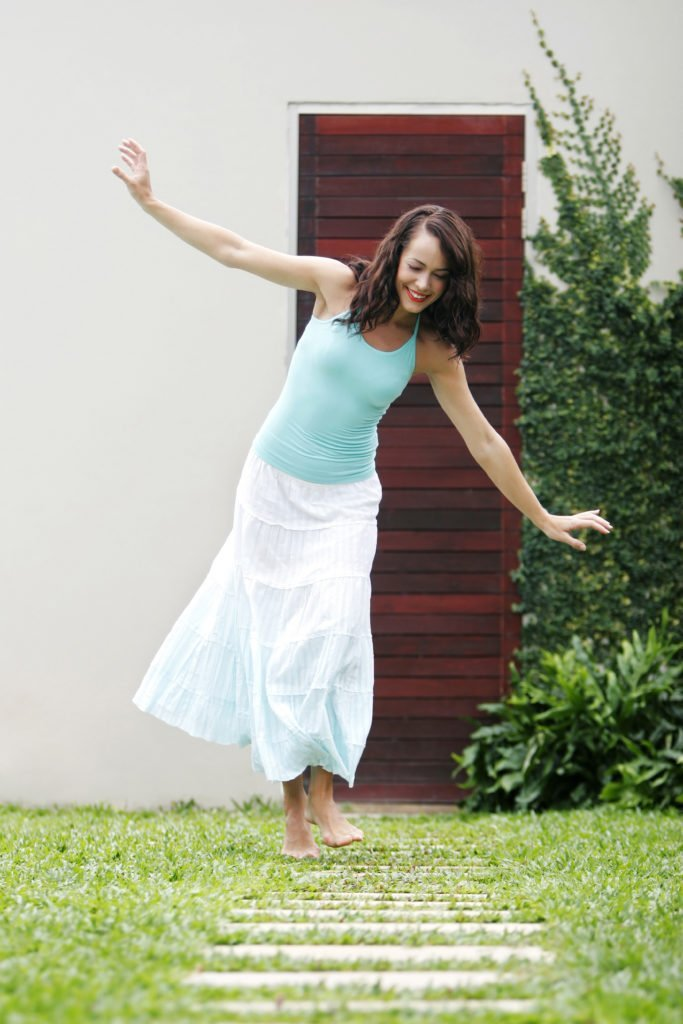 woman finding happiness, boosting mood naturally, easy unexpected ways to fight depression, dance to feel better