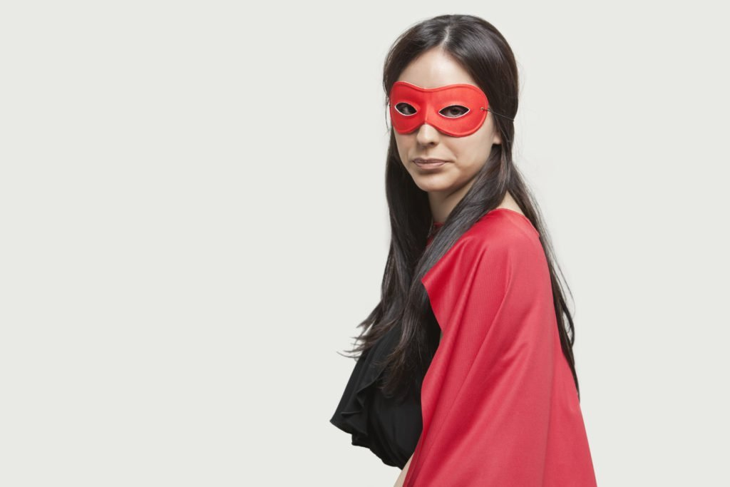Young woman in superhero costume, once abused by a narcissist, now confident and brave in recovery