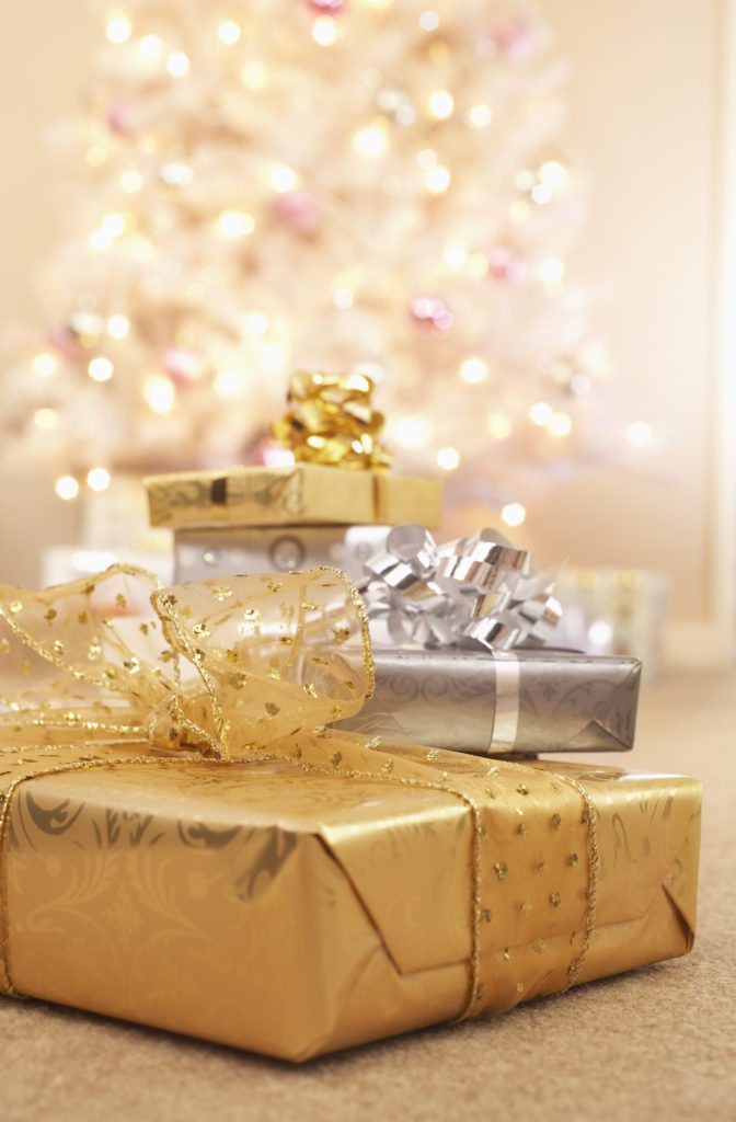 Get creative and set expectations early to keep Christmas gift spending low at the holidays.