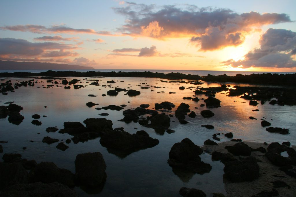 sunset over Shark's Cove on the North Shore of Hawaii where you will find amazing snorkling