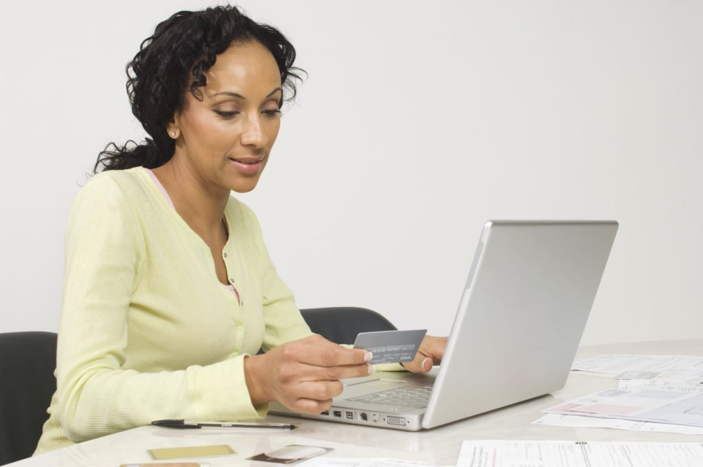 woman paying her credit card on time, save interest by paying credit card on time
