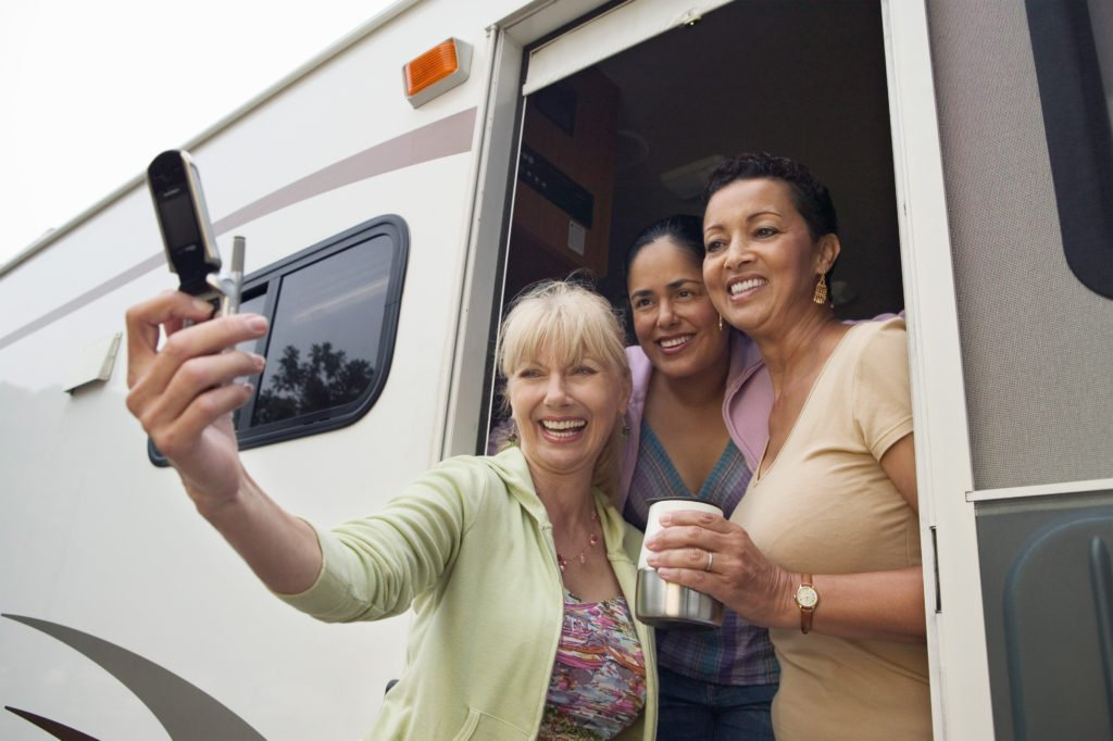 women on road trip in RV, how to avoid nausea on road, travel by car, tips for road trip